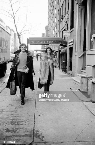 Belgianborn American fashion designer Diane von Furstenberg walks down a sidewalk with her husband Swiss baron Egon von Furstenberg New York New York...