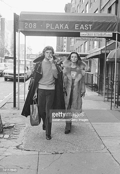 Belgianborn American fashion designer Diane von Furstenberg walks down a sidewalk with her husband Swiss baron Egon von Furstenberg New York New York...