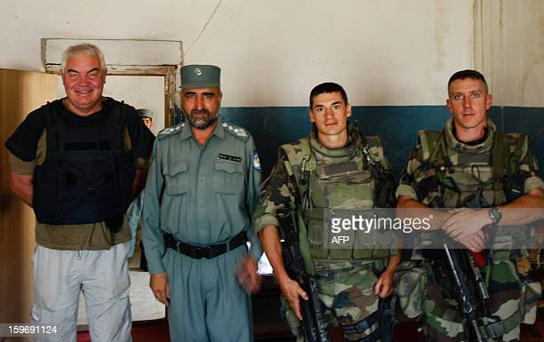 Belgianborn French journalist Yves Debay stands by a member of the Afghan police and 2 soldiers from the 1st Parachute regiment during a reportage in...