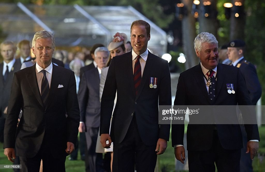 Belgian's King Philippe (L) and Britain's Prince William (C) with an unidentified person (R) walk at the Saint Symphorien Military cemetery on August 4, 2014 in Mons, Belgium, during commemorations marking 100 years since the invasion of Belgium by Germany at the start of World War I. World leaders on August 4 commemorated the 100th anniversary of the outbreak of World War I, a small Balkans conflict that went global with the German invasion of neutral Belgium in August 1914.