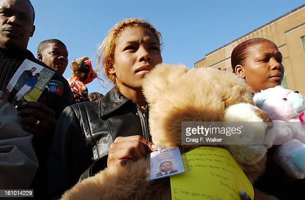 Belgica Sanchez of the Bronx comforts herself with a teddy bear given to her by her cousin Felix Sanchez as she displays his work ID badge Felix was...