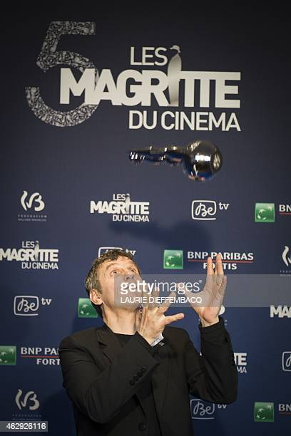 Belgium actor and director Lucas Belvaux poses on February 7 2015 with his award for scenario during the 5th Magritte du Cinema awards ceremony in...