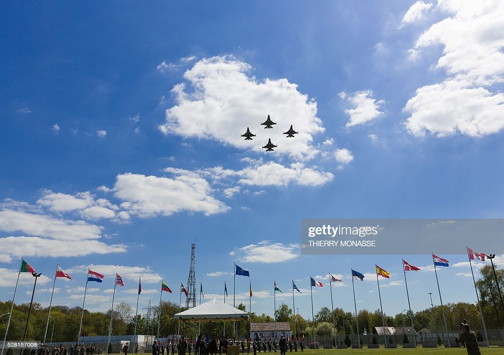 Belgium army F16 fighter aircrafts fly above the change of command ceremony for NATO's Supreme Allied Commander Europe (SACEUR) on May 4, 2016, at Supreme Headquarters Allied Powers Europe (SHAPE) in Mons. / AFP / Thierry Monasse