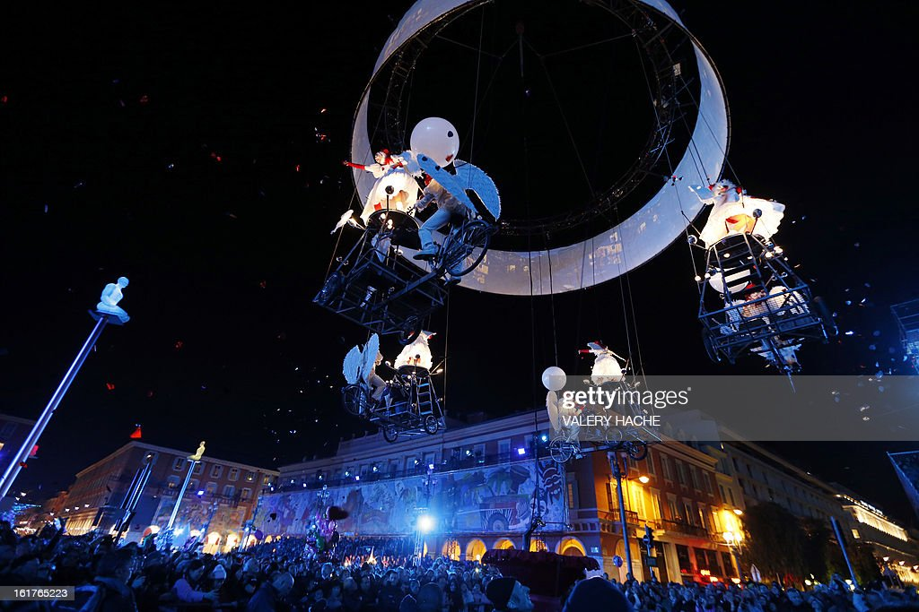 Belgium artists take part in the Nice Carnival parade on February 15, 2013 in Nice, southeastern France. The Carnival, starting from February 15 until March 6, 2013, will celebrate the 'King of the five continents' marking the 140th anniversary of the French Riviera Nice carnival.