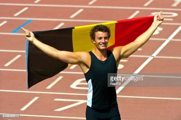 Belgium Athlete Celebrates with national Flag.