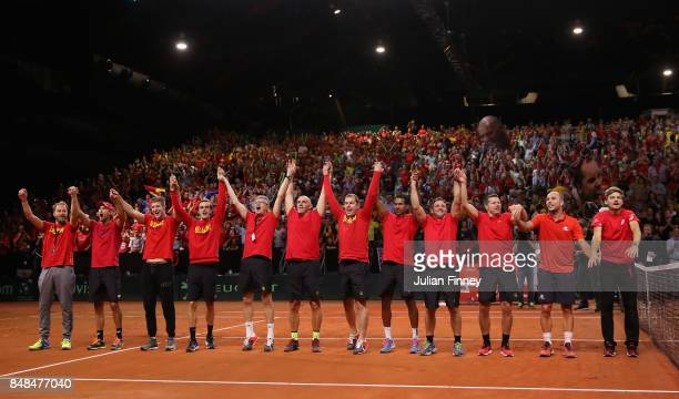 Belgium celebrate defeating Australia during day three of the Davis Cup World Group semi final match between Belgium and Australia at Palais 12 on...