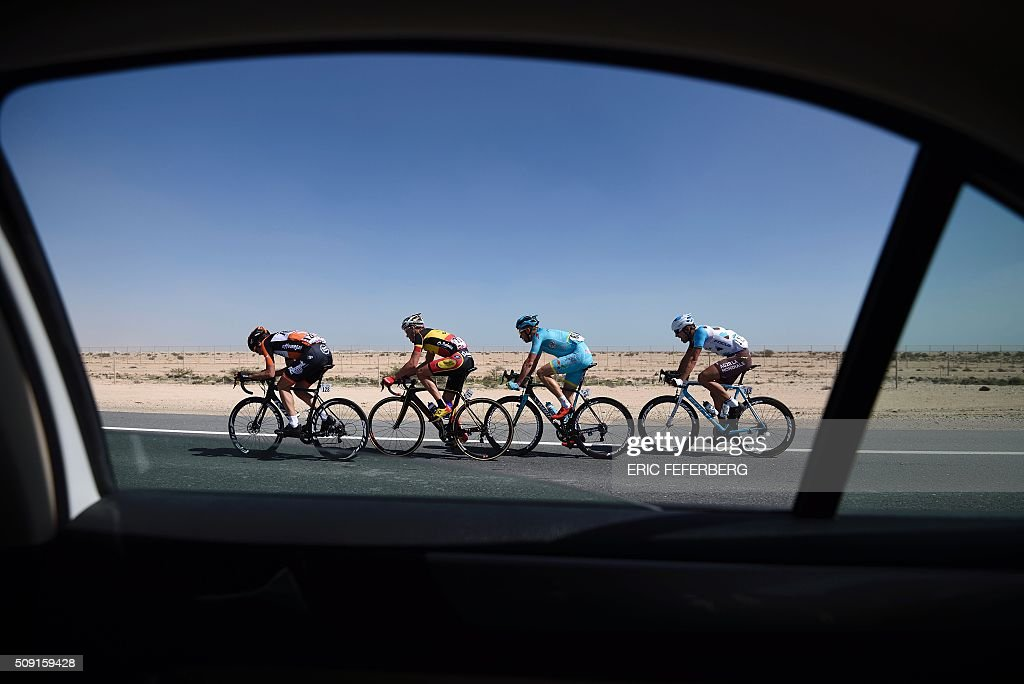 Belgium champion Top sport La Baloise's Preben Van Hecke (2L), Roompot Oranje Peloton's Brian Van Goethem (L), Astana Pro Team's Liewe Westra (2R) and AG2R La Mondiale's Gedminas Bagdonas (R) break-away in the desert during the second stage of the 2016 Tour of Qatar cycling race, starting and finishing at the Qatar University on February 9, 2016. Norway's Alexander Kristoff won a sprint finish ahead of Britain's Marc Cavendish in the second stage of the Tour of Qatar. FEFERBERG