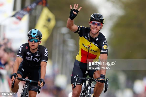 Belgium cyclist Philippe Gilbert of team Quick Step Floors celebrates next to Polish cyclist after winning for the forth time the Amstel Gold Race...