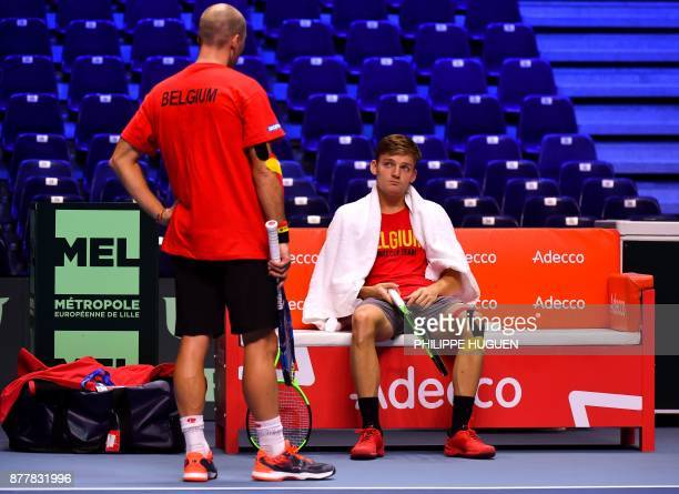 Belgium Davis Cup team captain Johan Van Herck speaks with his player David Goffin during a training session on November 23 2017 at the PierreMauroy...