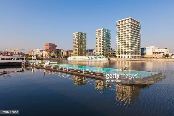 Belgium, Flanders, Antwerp, former dock area, swimming swimming pool, apartment buildings