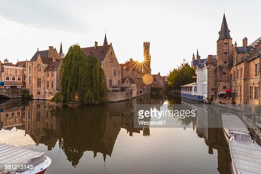 Belgium, Flanders, Bruges, Old town, Rozenhoedkaai, Canal and Belfry Tower