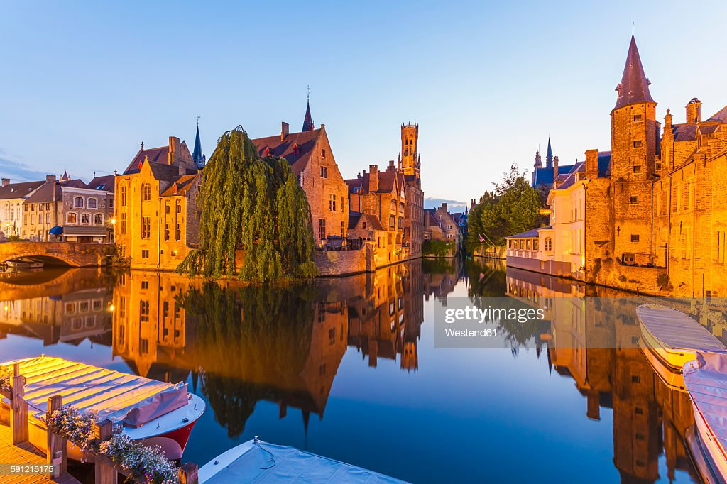Belgium, Flanders, Bruges, Old town, Rozenhoedkaai, Canal and Belfry Tower in the evening