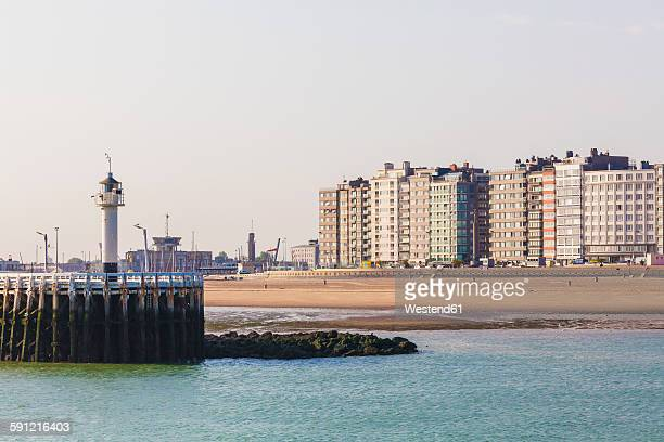 Belgium, Flanders, Ostende, North sea seaside resort, View to light house and beach