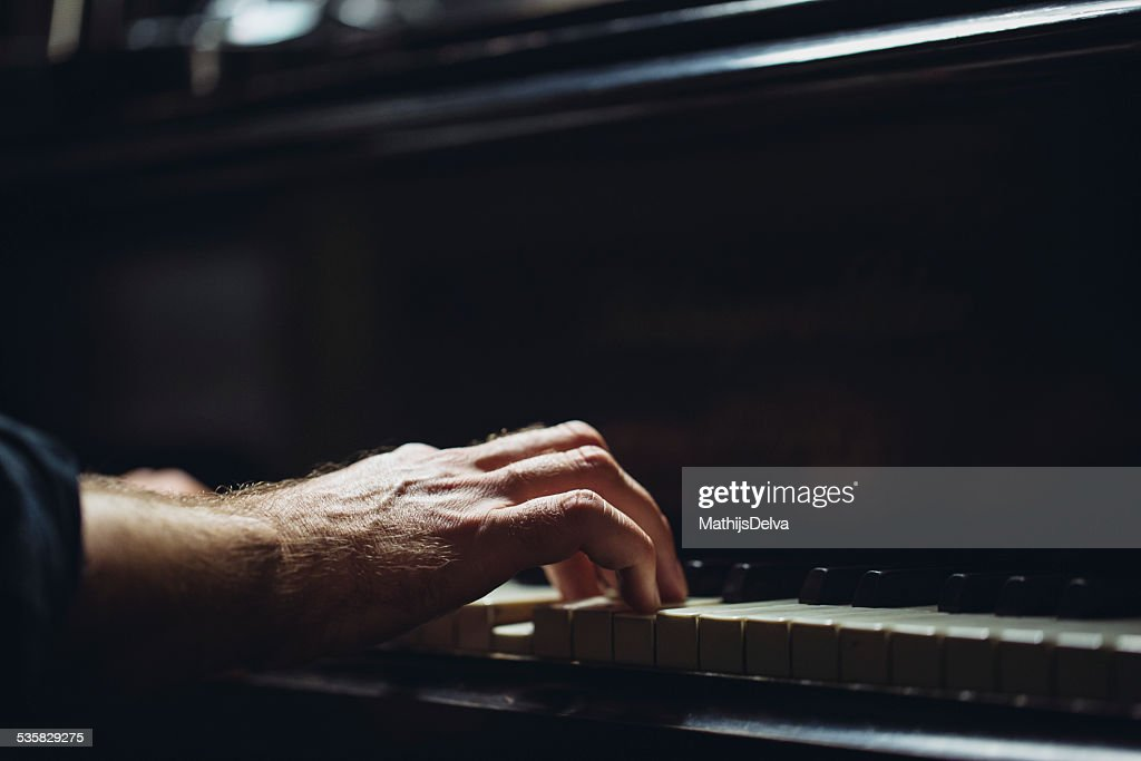 Belgium, Flanders, West Flanders, Brugge, Close-up of pianists hand on piano keyboard