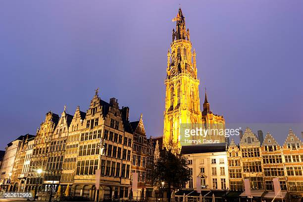 Belgium, Flemish Region, Antwerp, Illuminated Cathedral of Our Lady and townhouses