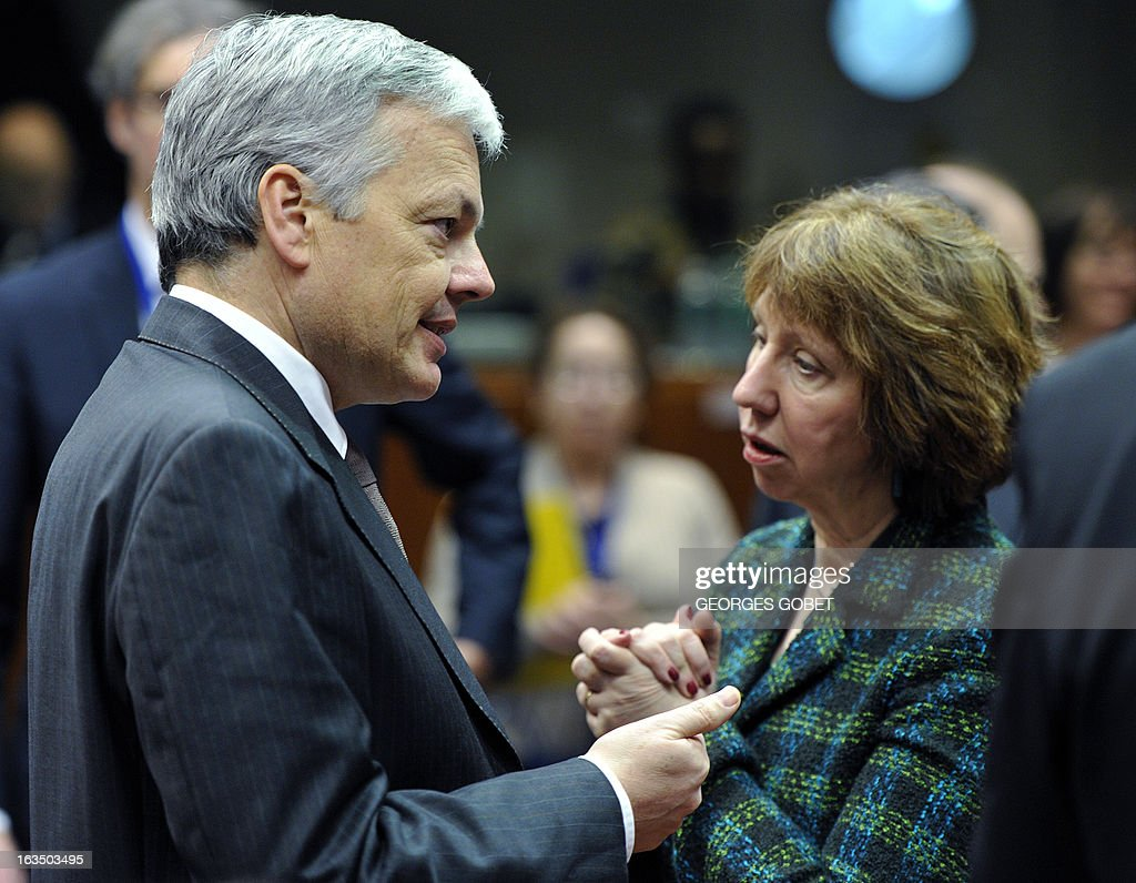 Belgium Foreign Minister Didier Reynders and High Representative of the European Union for Foreign Affairs and Security Policy Catherine Ashton (R) talk prior an Foreign Affairs Council on March 11, 2013 at the EU Headquarters in Brussels.AFP PHOTO GEORGES GOBET
