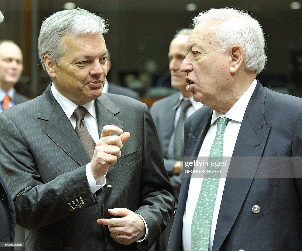 Belgium Foreign Minister Didier Reynders and Spanish Foreign Affairs Minister Jose Manuel Garcia Margallo (R) talk prior an Foreign Affairs Council on March 11, 2013 at the EU Headquarters in Brussels. AFP PHOTO GEORGES GOBET