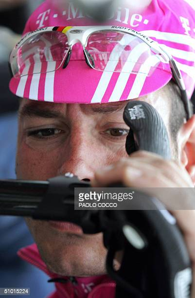 German Erik Zabel checks his saddle before a training session 01 July 2004 near Liege two days before the official start of the 91st Tour de France...