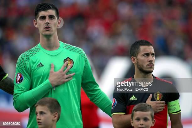 Belgium goalkeeper Thibault Courtois and Eden Hazard stand during their national anthem