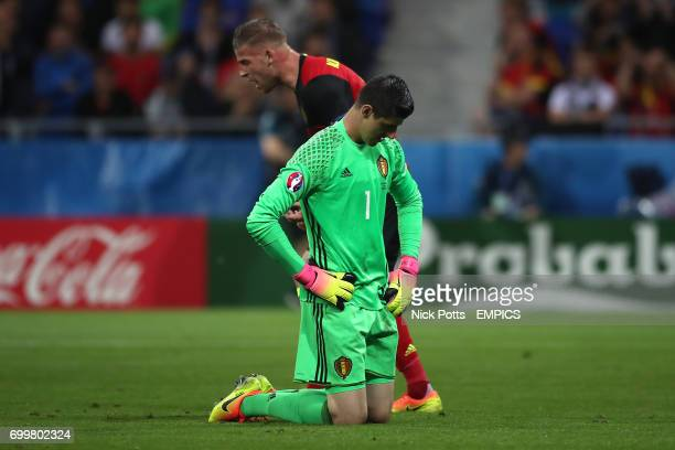 Belgium goalkeeper Thibault Courtois looks dejected after conceding his sides first goal of the game scored by Italy's Emanuele Giaccherini