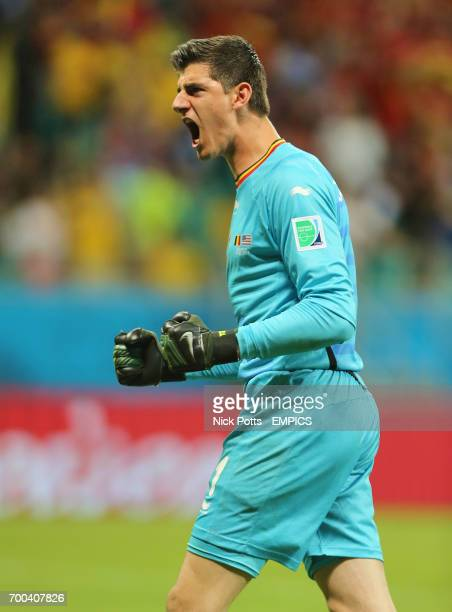 Belgium goalkeeper Thibaut Courtois celebrates after teammate Kevin De Bruyne scores his side's first goal in extratime