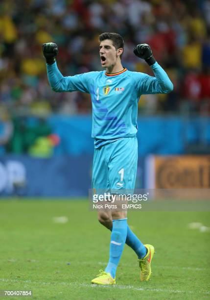 Belgium goalkeeper Thibaut Courtois celebrates after teammate Romelu Lukaku scores his side's second goal in extratime