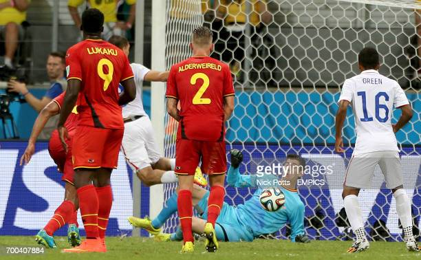 Belgium goalkeeper Thibaut Courtois makes a save from USA's Clint Dempsey after a wellworked freekick