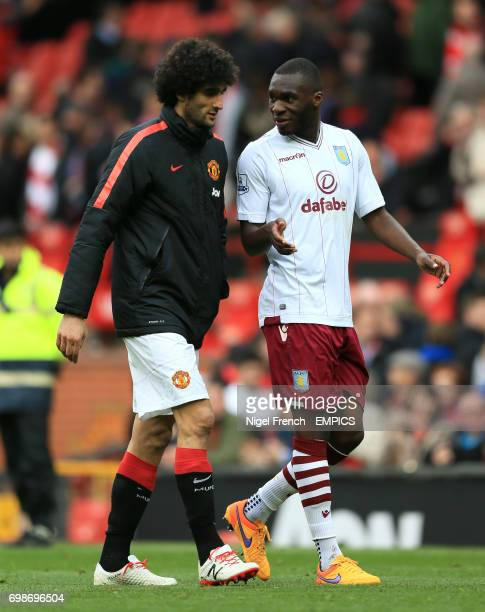 Belgium international team mates Manchester United's Marouane Fellaini and Aston Villa's Christian Benteke chat after the game