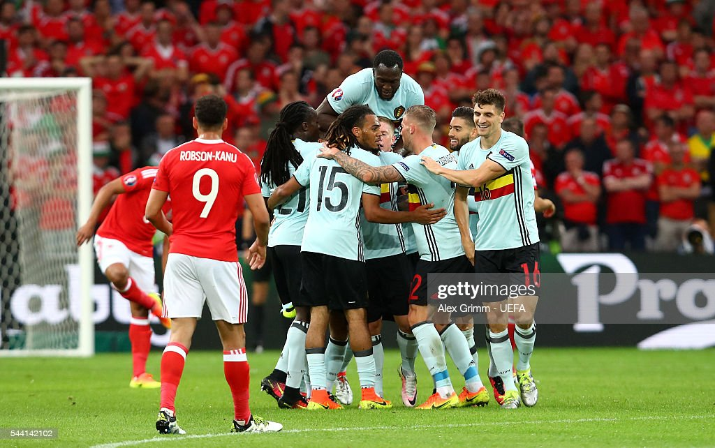 Belgium players celebrate their team's first goal by Radja Nainggolan (obscured) during the UEFA EURO 2016 quarter final match between Wales and Belgium at Stade Pierre-Mauroy on July 1, 2016 in Lille, France.
