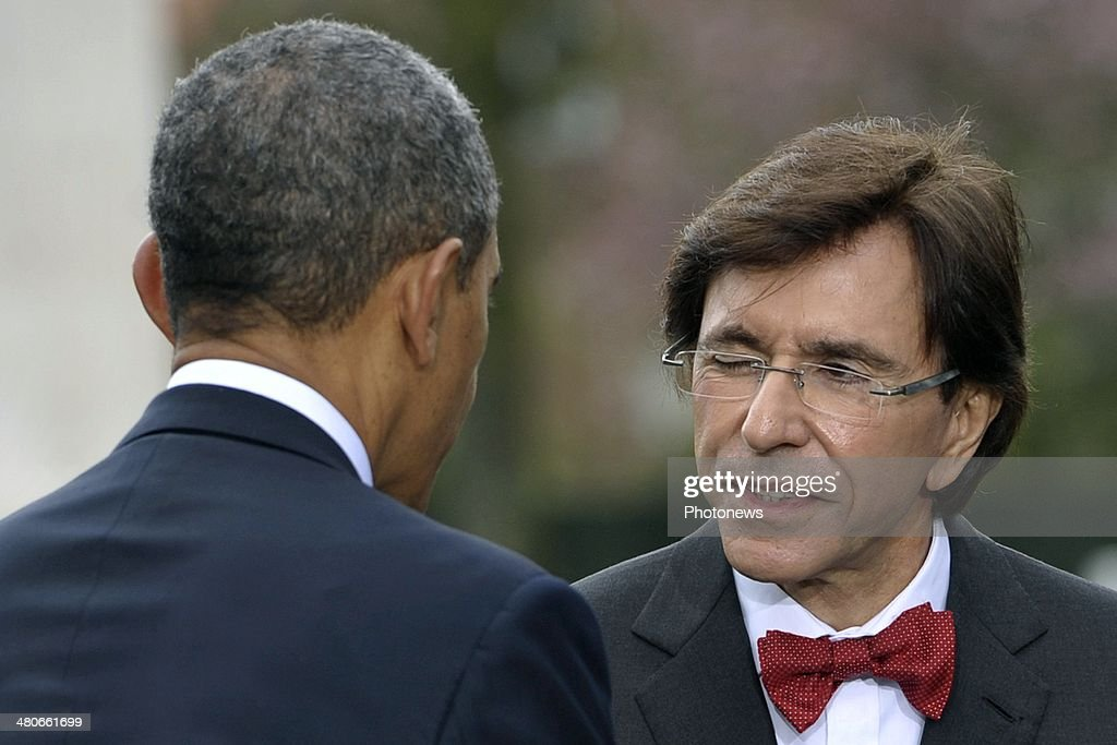 Belgium Prime Minister Elio Di Rupo winks at President of the United States Barack Obama during a visit to the Flanders Field American Cemetery and...