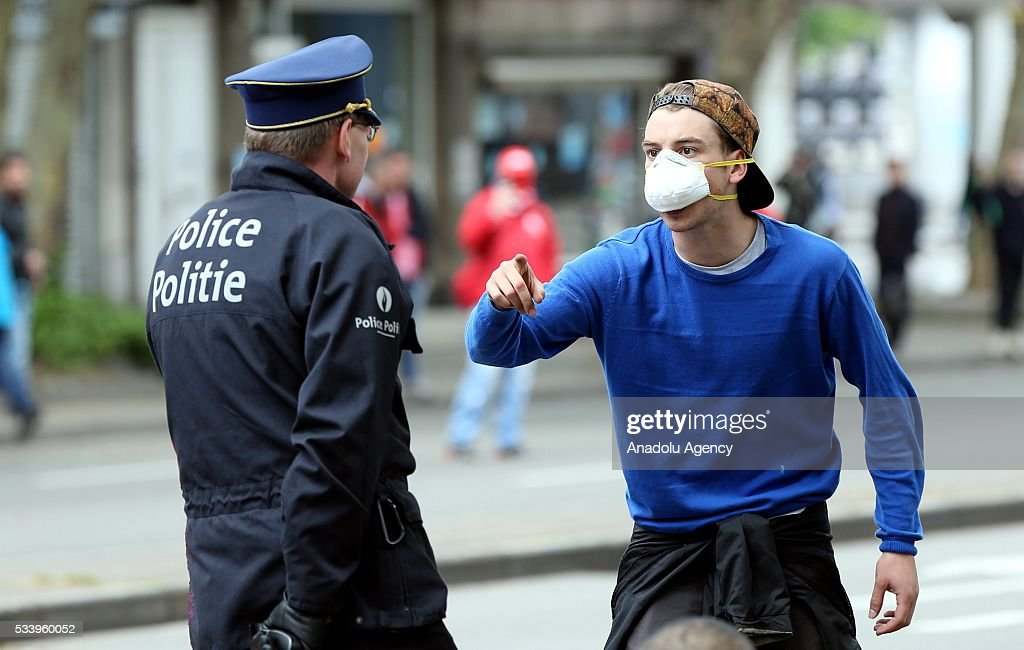 Belgium protester speaks with police during a national protest on May 24, 2016, in Brussels, Belgium. Belgian trade unions called for mass protest against the center-right government's social and economic policies.