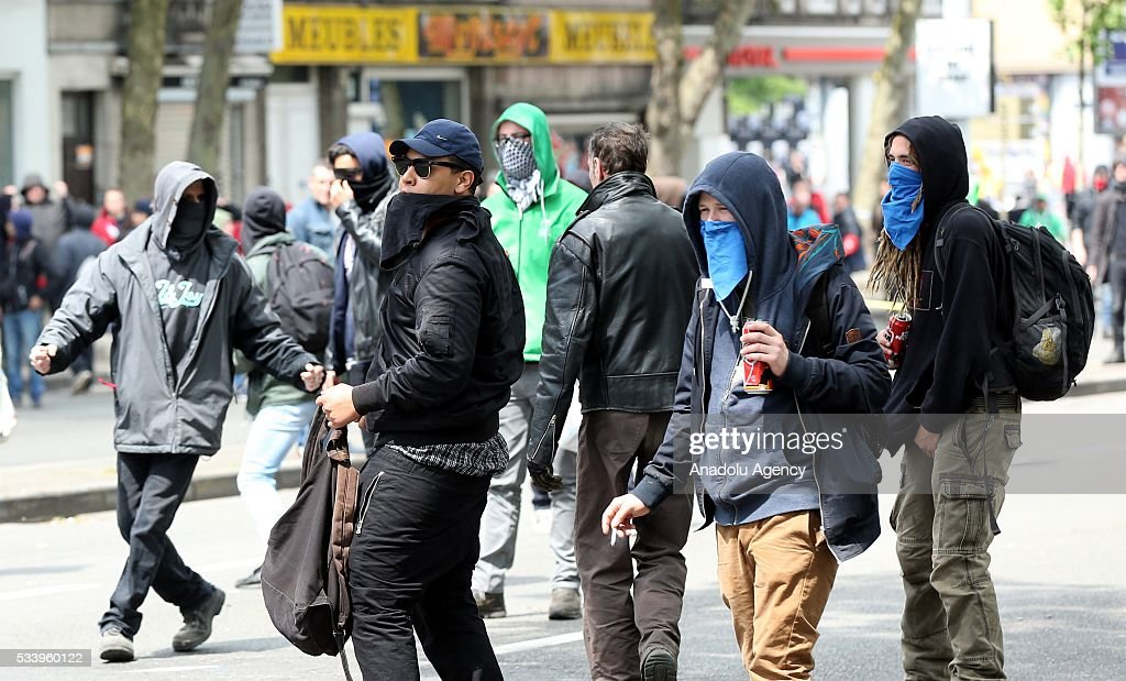 Belgium protesters clash with police during a national protest on May 24, 2016, in Brussels, Belgium. Belgian trade unions called for mass protest against the center-right government's social and economic policies.