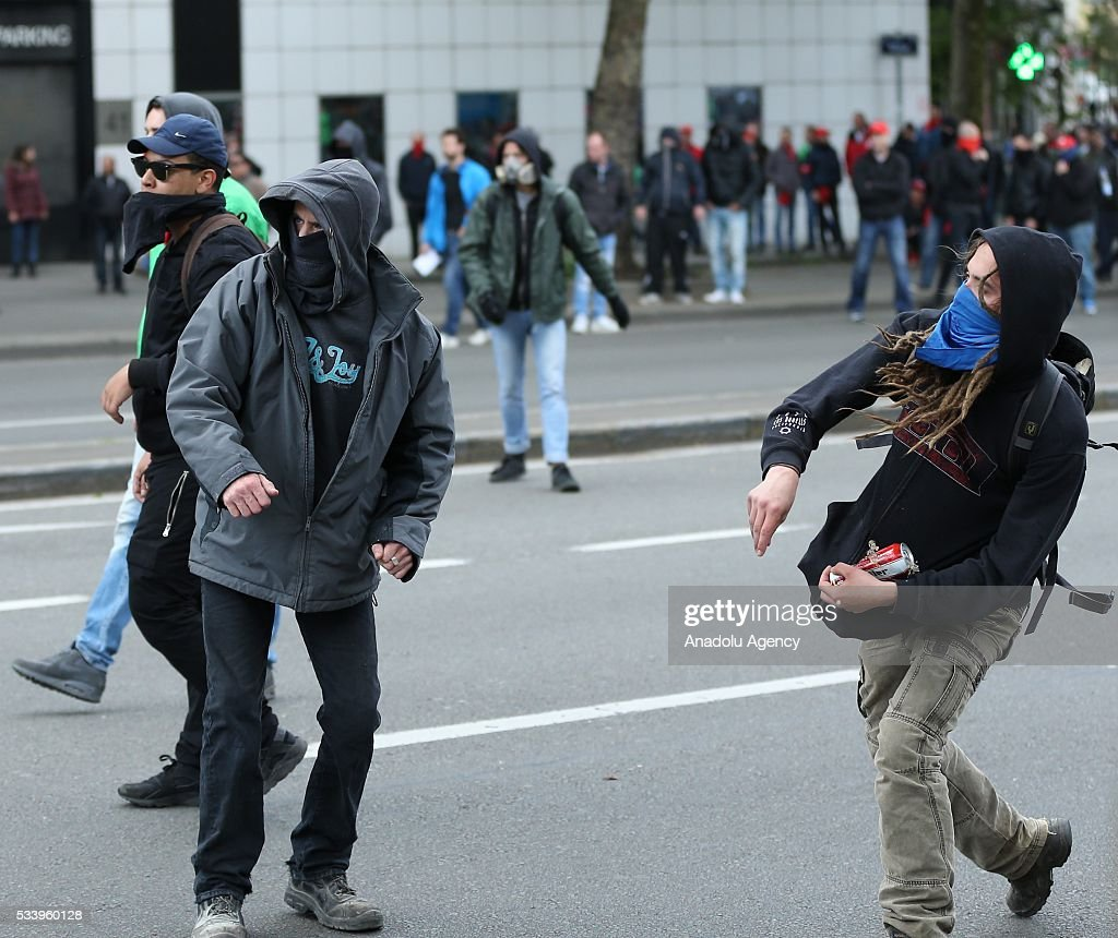 Belgium protesters throw stone to clash with police during a national protest on May 24, 2016, in Brussels, Belgium. Belgian trade unions called for mass protest against the center-right government's social and economic policies.