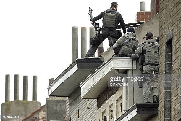 Belgium special force officers prepare to enter a house in the Rue Delaunoy in MolenbeekSaintJean of Brussels on November 16 several days after a...