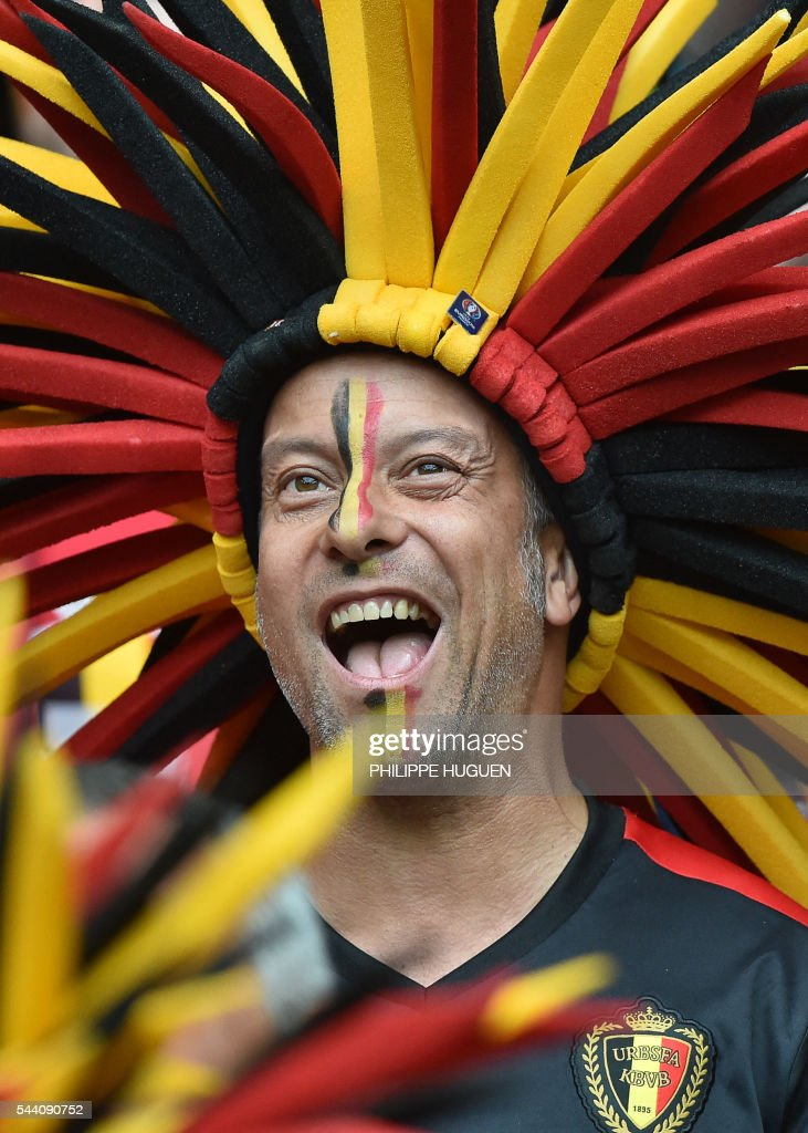 A Belgium supporter cheers for his team ahead of the Euro 2016 quarter-final football match between Wales and Belgium at the Pierre-Mauroy stadium in Villeneuve-d'Ascq near Lille, on July 1, 2016. / AFP / PHILIPPE