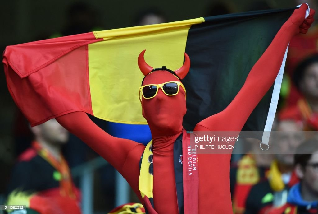 A Belgium supporter dressed as a 'Red Devil' cheers for his team ahead of the Euro 2016 quarter-final football match between Wales and Belgium at the Pierre-Mauroy stadium in Villeneuve-d'Ascq near Lille, on July 1, 2016. / AFP / PHILIPPE