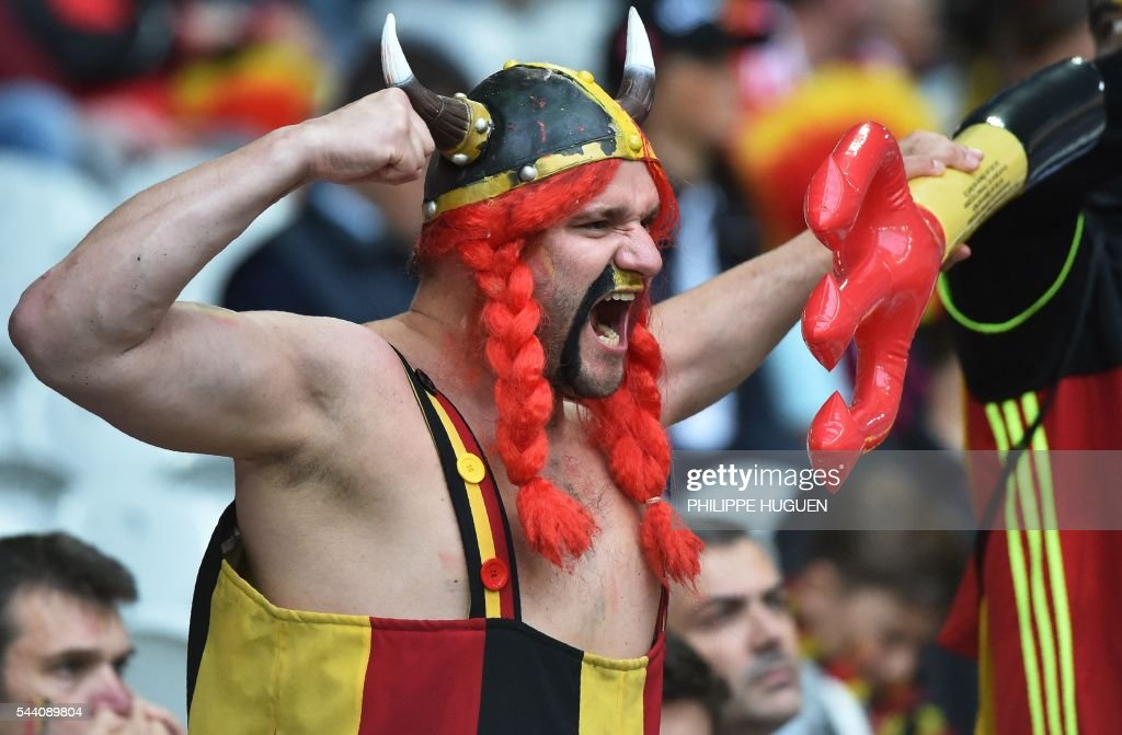 A Belgium supporter gestures before the Euro 2016 quarter-final football match between Wales and Belgium at the Pierre-Mauroy stadium in Villeneuve-d'Ascq near Lille, on July 1, 2016. / AFP / PHILIPPE