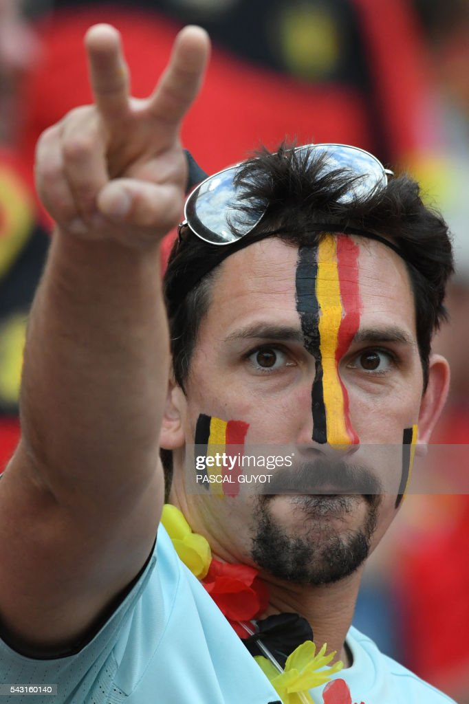 A Belgium supporter gestures prior to the Euro 2016 round of 16 football match between Hungary and Belgium at the Stadium Municipal in Toulouse on June 26, 2016. / AFP / PASCAL