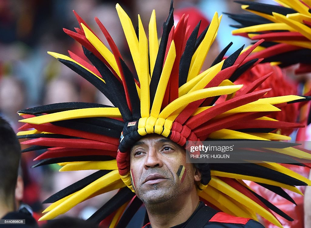 A Belgium supporter poses before the Euro 2016 quarter-final football match between Wales and Belgium at the Pierre-Mauroy stadium in Villeneuve-d'Ascq near Lille, on July 1, 2016. / AFP / PHILIPPE