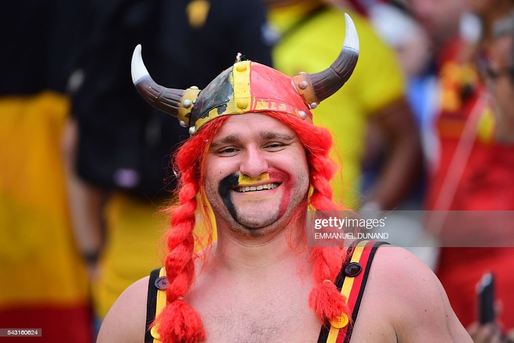 A Belgium supporter smiles prior to the Euro 2016 round of 16 football match between Hungary and Belgium at the Stadium Municipal in Toulouse on June 26, 2016. / AFP / EMMANUEL
