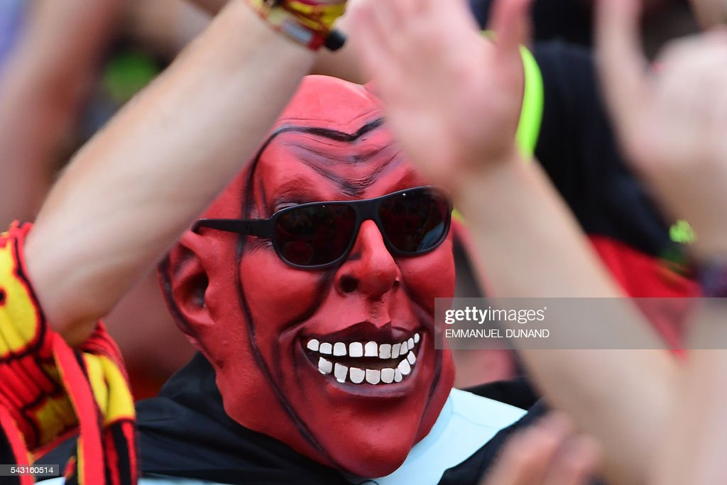 A Belgium supporter wears a mask prior to the Euro 2016 round of 16 football match between Hungary and Belgium at the Stadium Municipal in Toulouse on June 26, 2016. / AFP / EMMANUEL