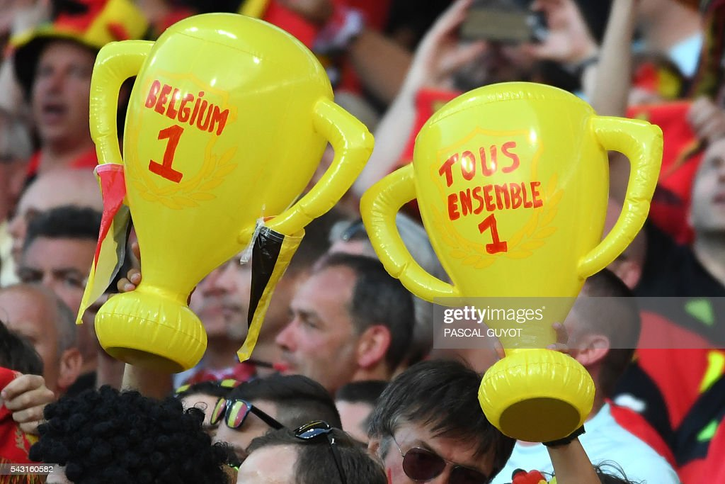 Belgium supporters hold infltable trophies prior to the Euro 2016 round of 16 football match between Hungary and Belgium at the Stadium Municipal in Toulouse on June 26, 2016. / AFP / PASCAL
