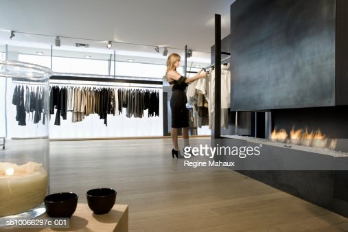 Belgium, woman looking at clothes in shop : ストックフォト