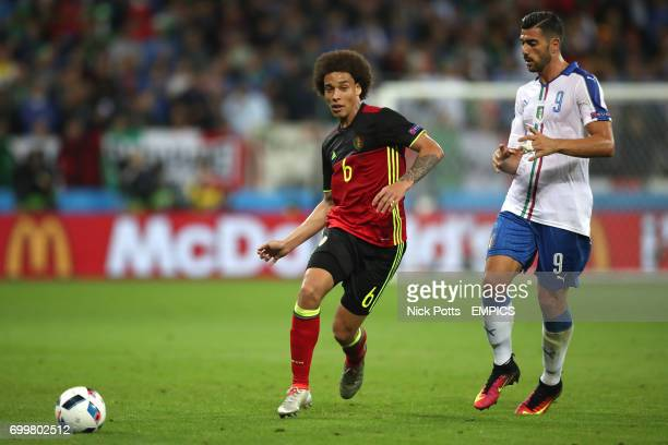 Belgium's Axel Witsel and Italy's Graziano Pelle battle for the ball
