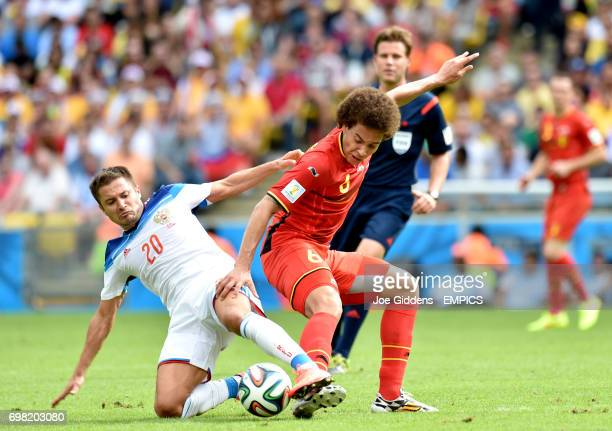 Belgium's Axel Witsel and Russia's Viktor Fayzulin battle for the ball