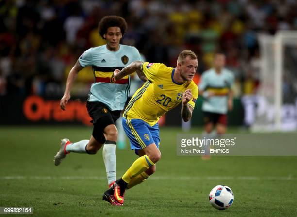 Belgium's Axel Witsel and Sweden's John Guidetti battle for the ball