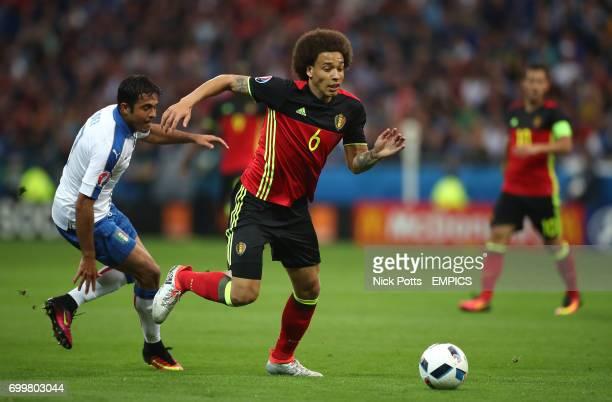 Belgium's Axel Witsel gets away from Italy's Eder