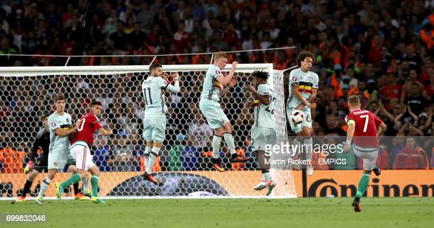 Belgium's Axel Witsel takes the block from the free kick by Hungary's Balazs Dzsudzsak