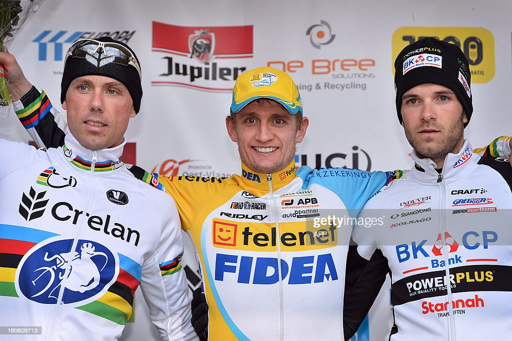 Belgium's Bart Wellens (C) celebrates on the podium on February 6, 2013 with second placed Sven Nys and third placed Niels Albert after he won the 7th edition of the Parkcross Maldegem cyclocross race in Maldegem.