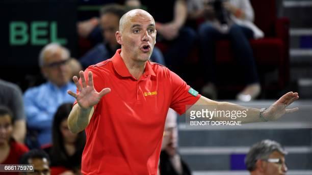 Belgium's captain Johan Van Herck reacts during the Davis Cup World Group quarterfinal between Belgium and Italy on April 8 in Charleroi / AFP PHOTO...